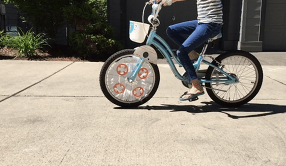 child riding a bike with the BB-8 DIY completed design