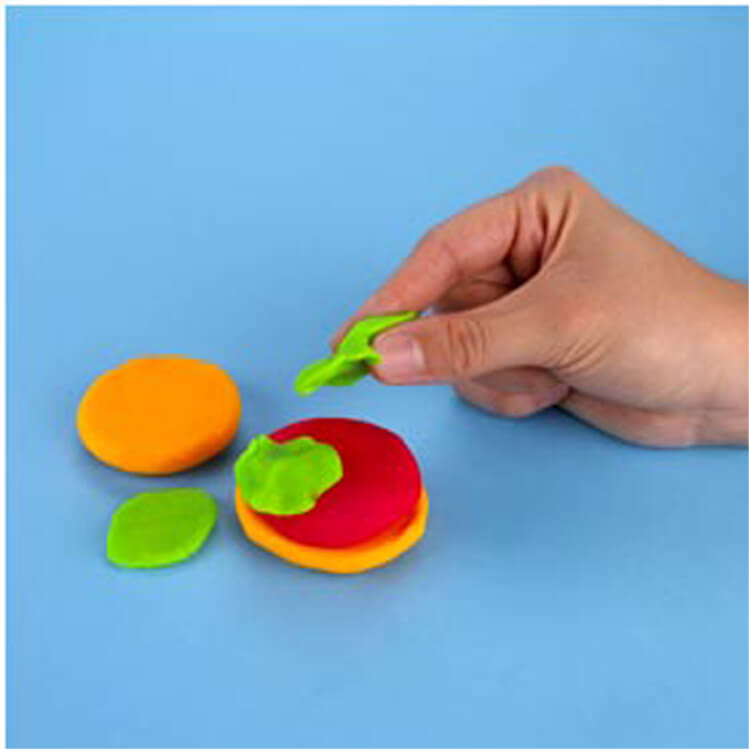 how to make a pretend hamburger with PlayDoh dough compound step two