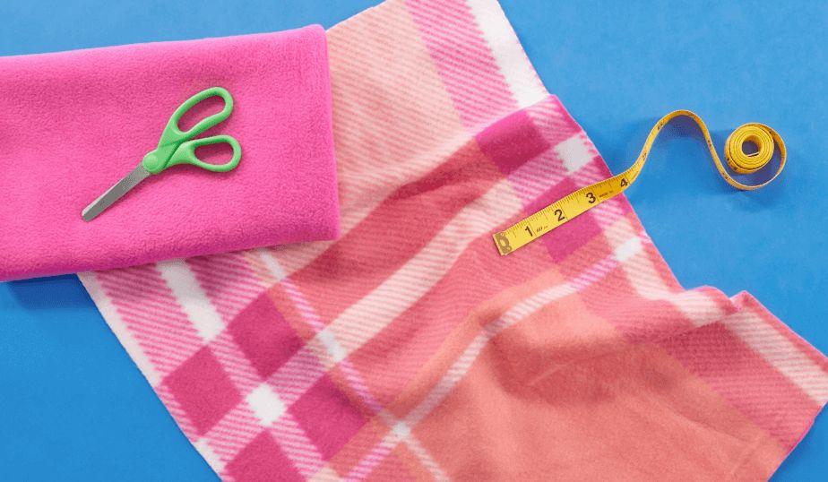 fleece material, scissors, measuring tape