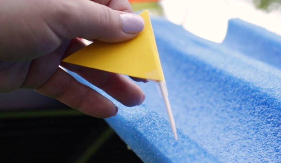make racing flags using cardstock and toothpicks