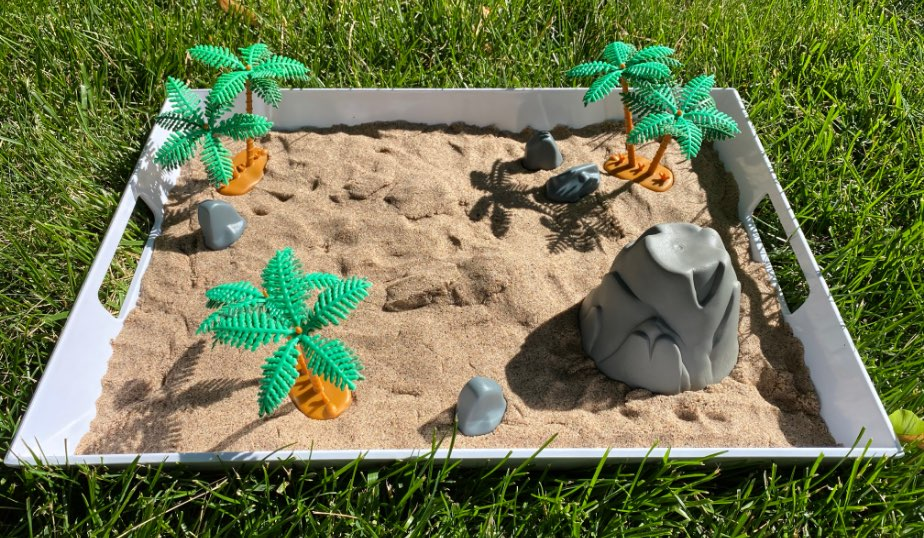 kinetic sand and animal planet dinosaur figures in the dino discovery box diy for kids