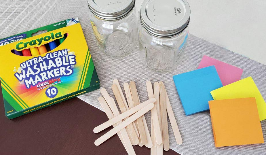 flat lay of the supplies for mason jar activities jar diy activity for kids