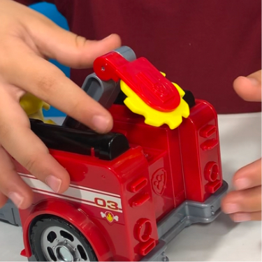 young kid playing with the PAW Patrol Marshall Transforming Fire Truck play vehicle toy