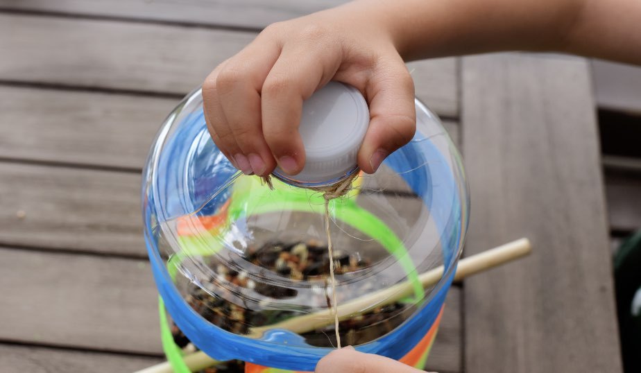 twine wrapped around the do it yourself bird feeder, an activity for kids