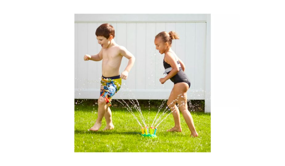 kids playing in the backyard with the Melissa & Doug Sunny Patch Splash Patrol Sprinkler