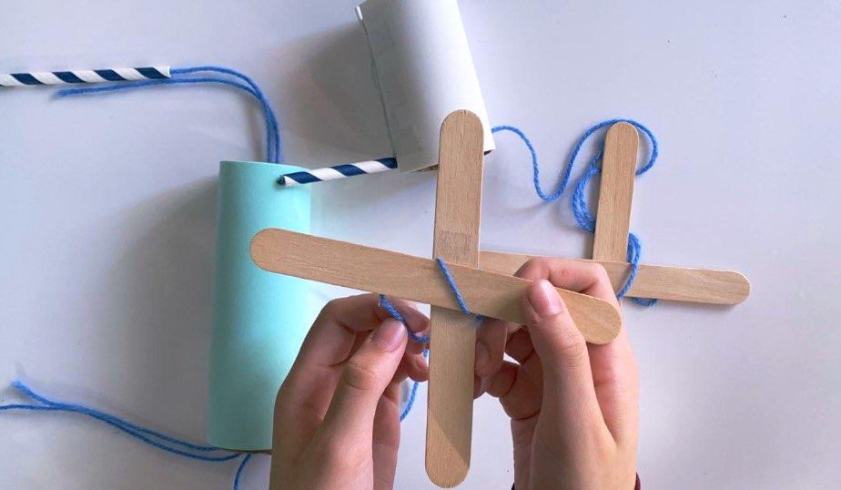 "Fasten craft sticks to make an ""X"" shape"