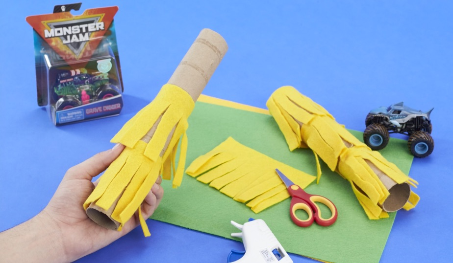 use scissors to cut a paper towel roll