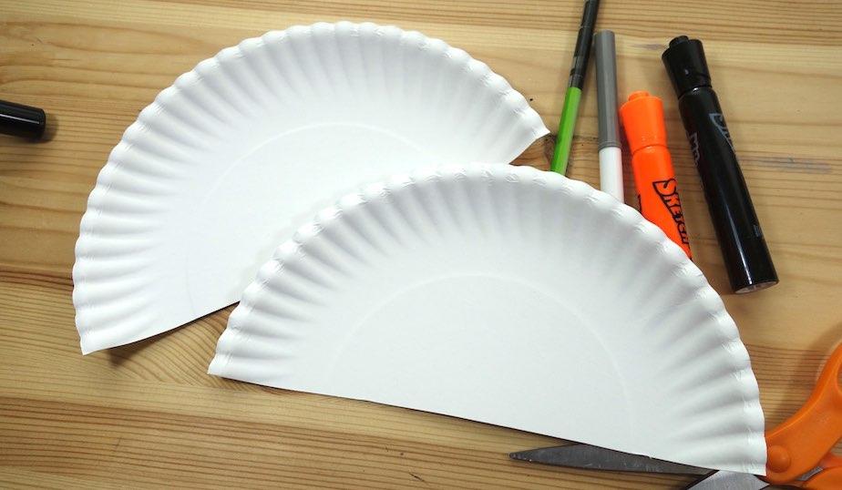 white paper plate cut in half