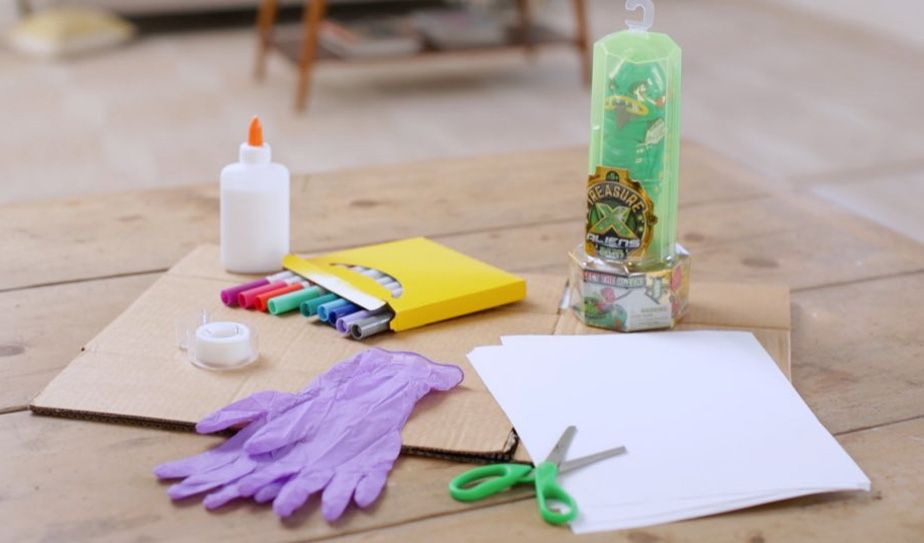 cardboard, Treasure X Aliens, paper, markers, glue, tape, scissors, hobby knife, rubber gloves