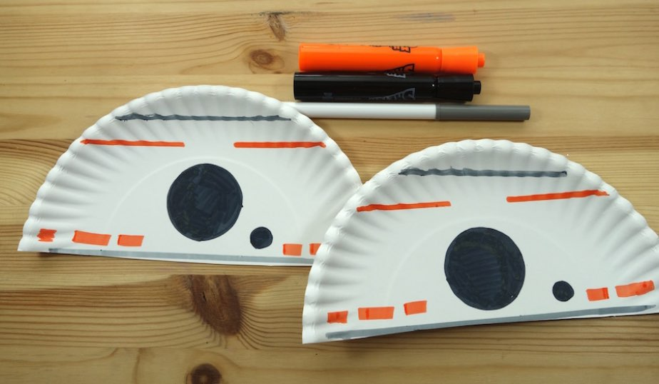 white paper plate halves with BB-8 design