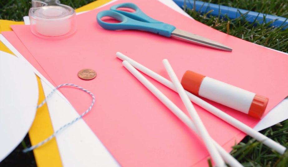 card stock, scissors, tape, straws, penny