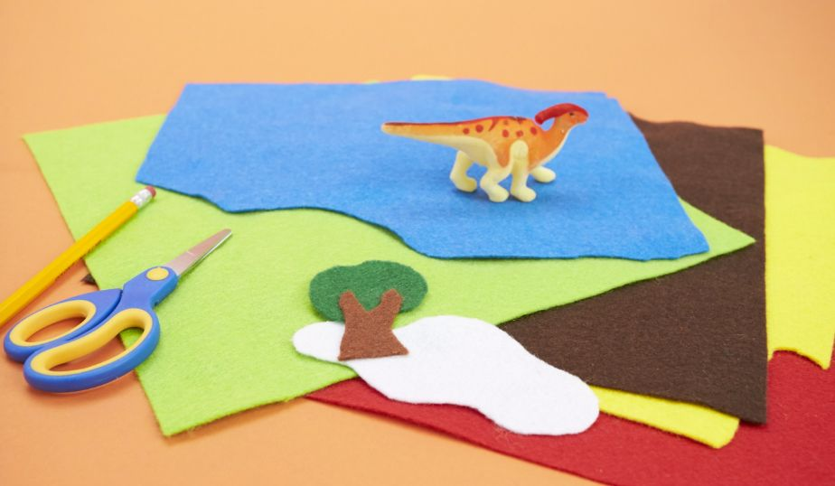 cut out felt shapes of trees and mountains
