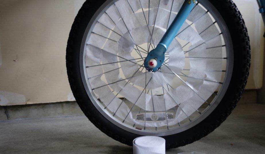 white crepe streamer inside bike wheel spokes